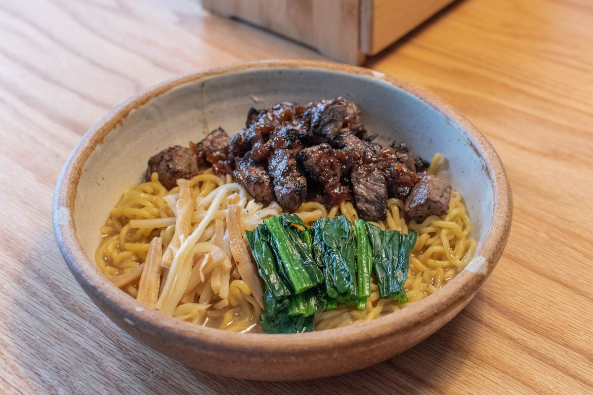 Steak mazemen at Niche comes in a ceramic bowl, featuring noodles with pieces of steak on top