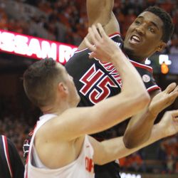 Louisville's Donovan Mitchell, right, grabs a rebound from Syracuse's Tyler Lydon, left, in the second half of an NCAA college basketball game in Syracuse, New York, Monday, Feb. 13, 2017. Louisville won 76-72.