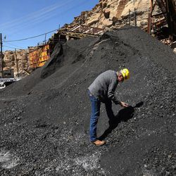 Dan Baker, CEO and president of the Bronco Utah Mine, looks over a coal stack pile at the mine near Emery on Wednesday, March 29, 2017.