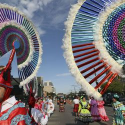 Jesus Rangel wears an Indigenous Pueblo penachos to march in the Days of '47 Parade with the Consulate of Mexico in Salt Lake City on Friday, July 23, 2021.
