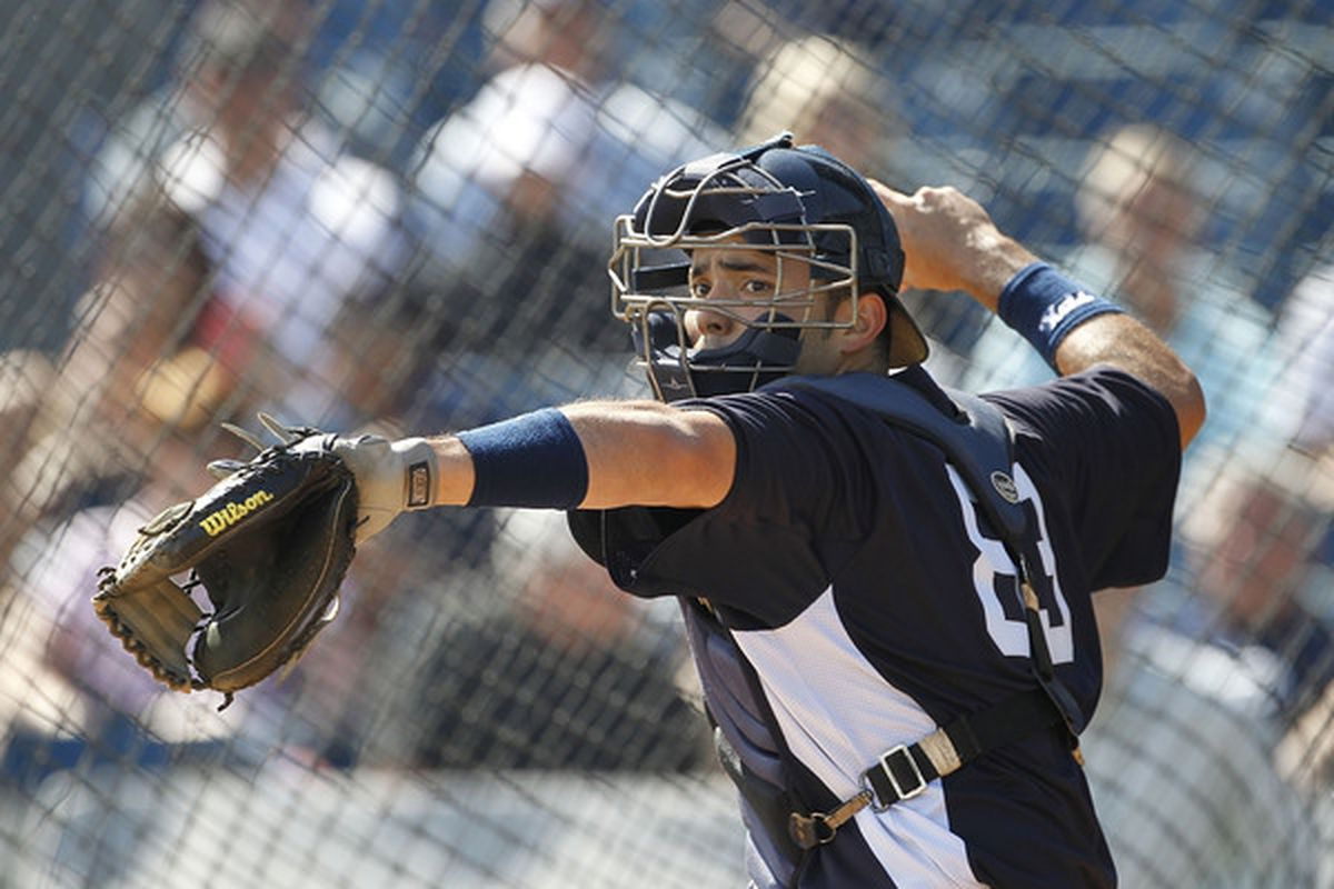 TAMPA FL - FEBRUARY 21: Jesus Montero #83 of the New York Yankees works out during the second day of full teams workouts at Spring Training on February 21 2011 at the George M. Steinbrenner Field in Tampa Florida.  (Photo by Leon Halip/Getty Images)