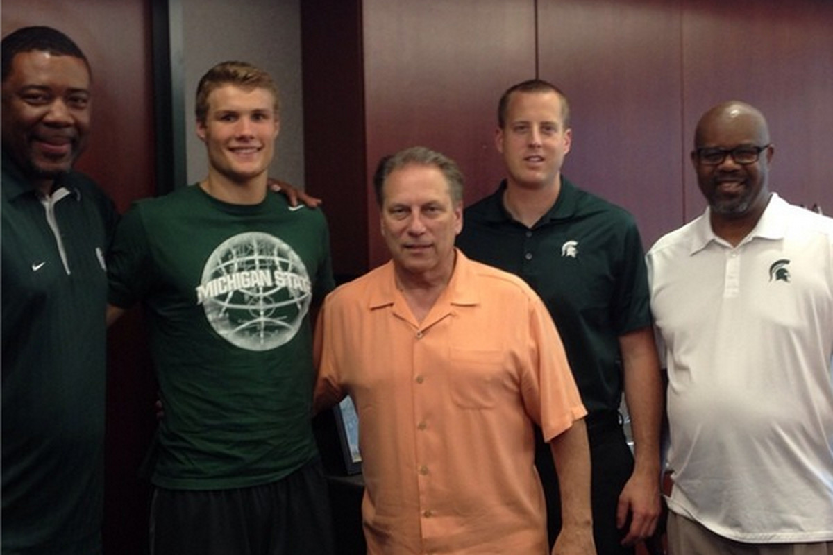 Versailles shooting guard Kyle Ahrens becomes Michigan State's second member of the 2015 class.