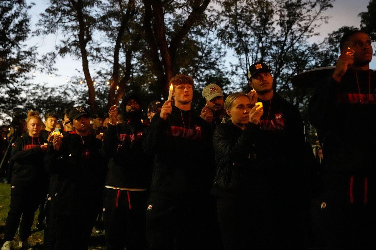 University of Utah athletes hold candles during a vigil for slain University of Utah football defensive back Aaron Lowe.
