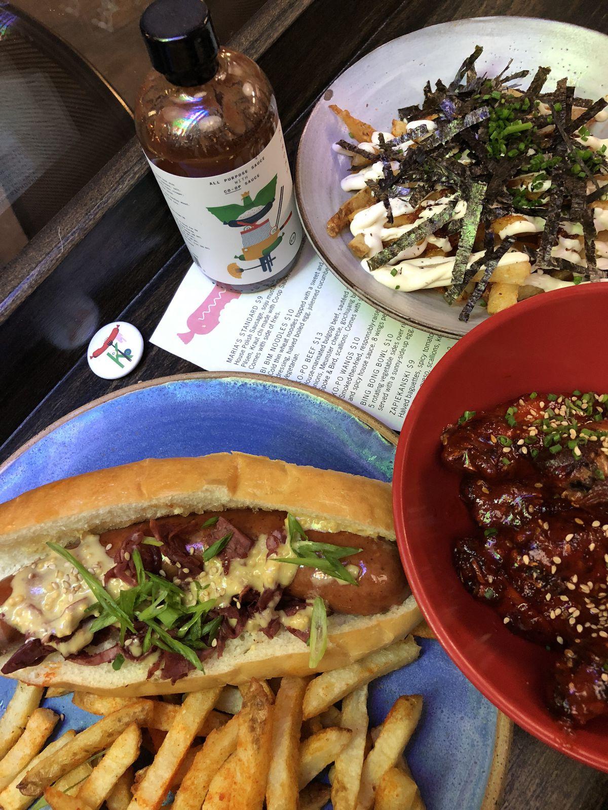 Customer favorites at Kimski in Bridgeport including Maria's Standard (sausage), Kopo Wings, Kimski Poutine.   Ji Suk Yi/ Sun-Times