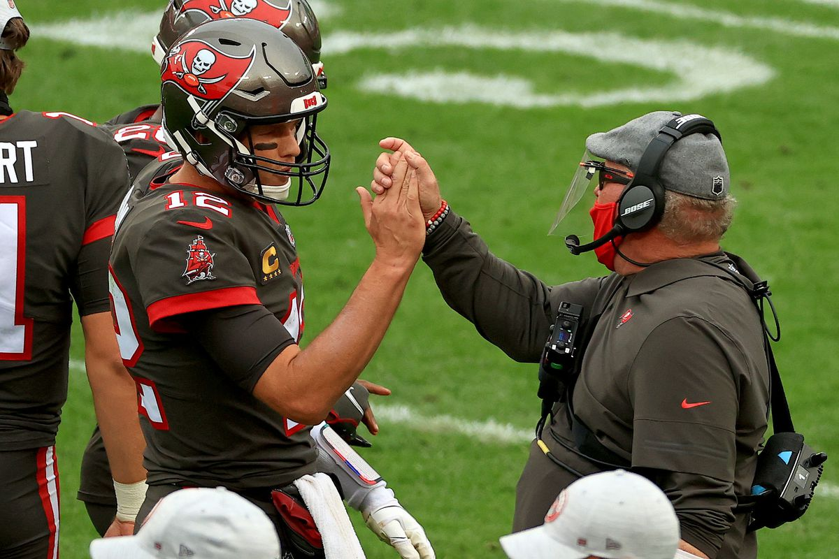 Tom Brady #12 of the Tampa Bay Buccaneers celebrates a touchdown with head coach Bruce Arians of the Tampa Bay Buccaneers during a game against the Atlanta Falcons at Raymond James Stadium on January 03, 2021 in Tampa, Florida.