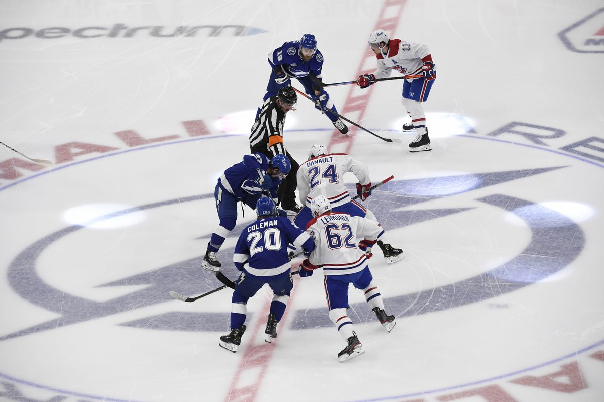 Tampa Bay Lightning center Yanni Gourde (37) takes the opening face off against Montreal Canadiens left wing Phillip Danault (24) in the first period of game one of the 2021 Stanley Cup Final at Amalie Arena.