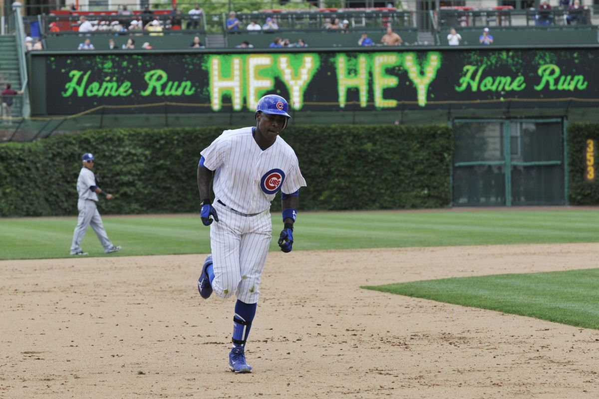 Alfonso Soriano of the Chicago Cubs hits a solo home run against the San Diego Padres at Wrigley Field in Chicago, Illinois.  (Photo by David Banks/Getty Images)