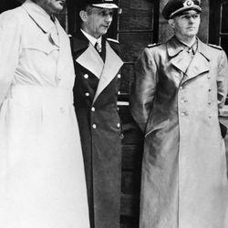 """Members of Germany's WW II """"Doenitz'"""" government, Minister for Armaments and War Production Albert Speer, left, Grand Admiral Karl Doenitz, center, and Gen.l Alfred Jodl wait in a courtyard in Flensburg, Germany, after their arrest by British troops on May 24, 1945, by order of the Supreme Allied Commander, Gen. Dwight Eisenhower."""