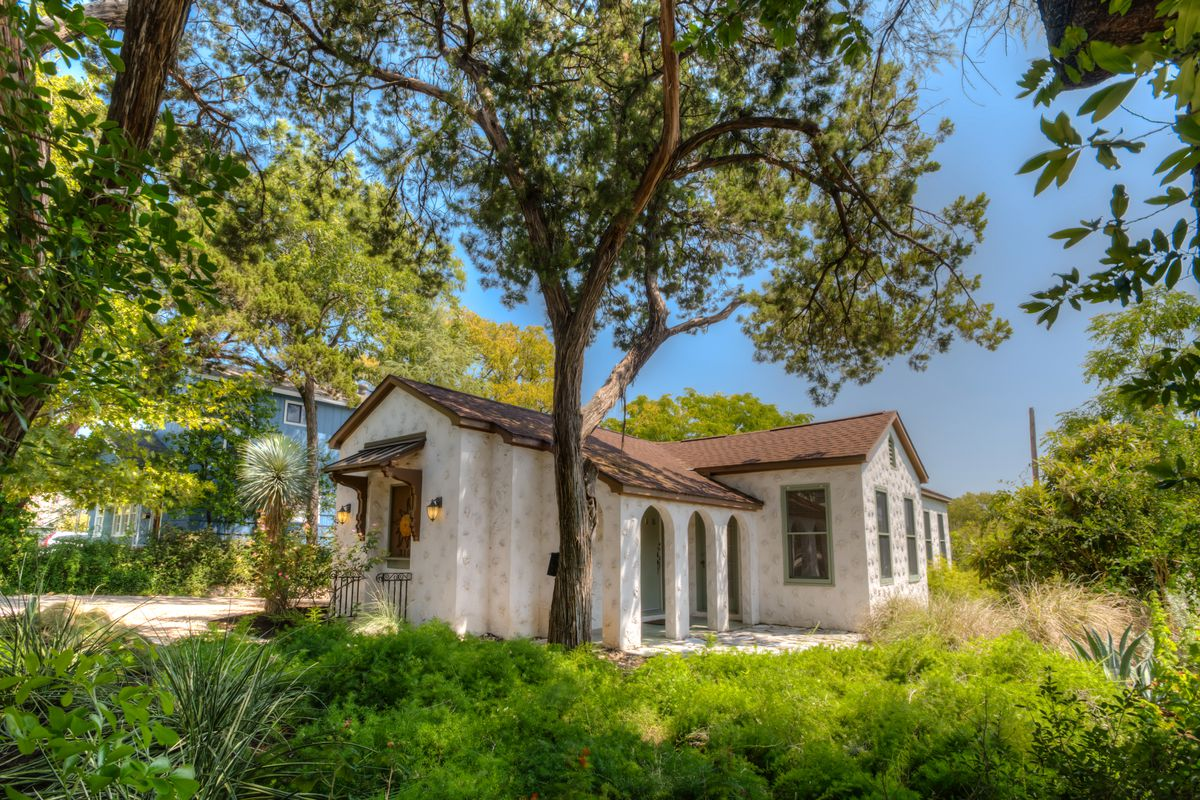 small one story white stucco home