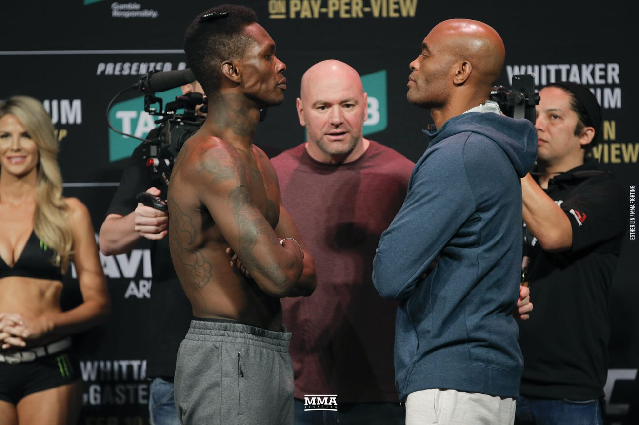 Israel Adesanya faces off with Anderson Silva ahead of their middleweight main event bout at UFC 234 on Saturday at Rod Laver Arena in Melbourne, Australia