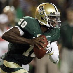 FOR USE AS DESIRED WITH NFL DRAFT STORIES - FILE - In this Nov. 19, 2011, file photo, Baylor quarterback Robert Griffin III looks to pass in the first half of an NCAA college football game against Oklahoma in Waco, Texas. Griffin is a top prospect in the upcoming NFL football draft.
