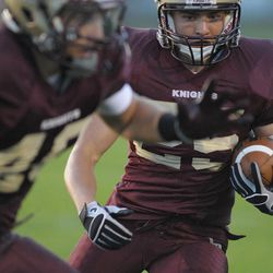 Lone Peak's Michael Lindeman runs with the ball. Timpview reigned supreme over Lone Peak 36-33.