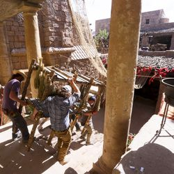 """Crew members move a piece of the set during filming of a faith-based streaming series on the life of Jesus Christ called """"The Chosen"""" at The Church of Jesus Christ of Latter-day Saints' Jerusalem set in Goshen, Utah County, on Monday, Oct. 19, 2020."""
