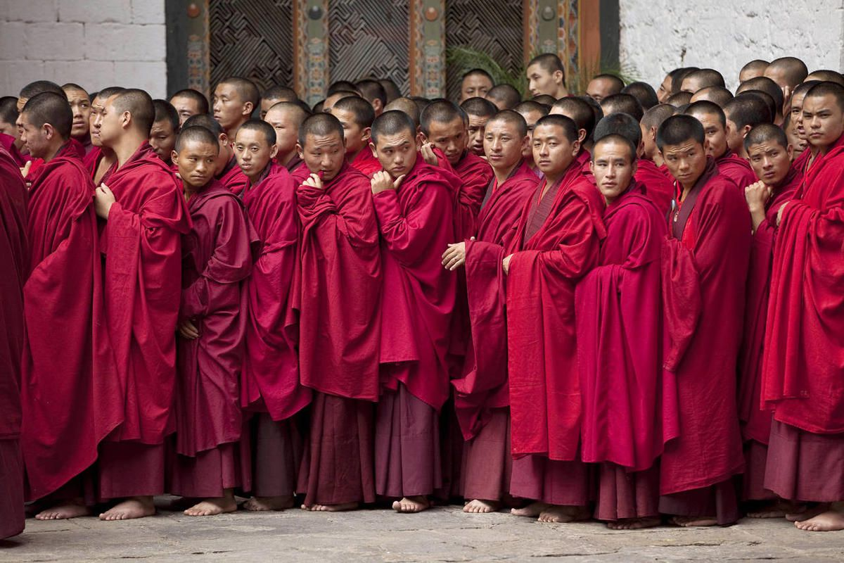 Buddhist monks wait to take part in the marriage ceremony of King Jigme Khesar Namgyal Wangchuck and Queen Jetsun Pema at the Punakha Dzong, in Punakha, Bhutan, Thursday, Oct. 13, 2011. The 31 year-old reformist monarch of the small Himalayan Kingdom wed
