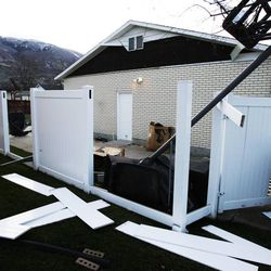 Wind damage to a home and fence in Farmington, Thursday, Dec. 1, 2011.