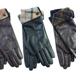 """Tartan-lined <a href=""""http://www.barbour.com/us/womens-clothing/gloves/leather/accessories/lady-jane-leather-glove"""">Lady Jane Leather Gloves</a> ($64)."""