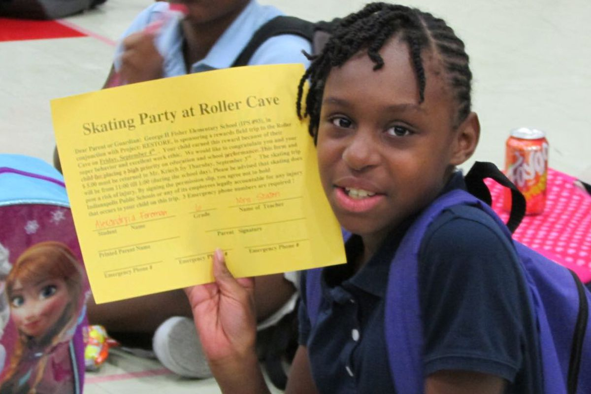 """A student with a """"golden ticket"""" for a skating party as a reward for good work at School 93. As a Project Restore school, it is an example of an IPS school that operates with a degree of independence."""