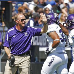 Weber State coach Jody Sears encourages his players during the first half as Brigham Young University plays Weber State University in football  Saturday, Sept. 8, 2012, in Provo, Utah.