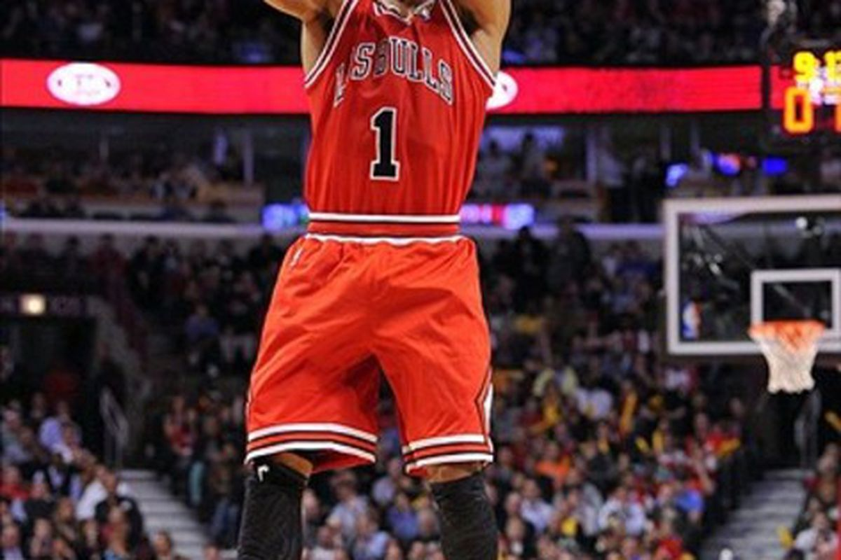 Mar 12, 2012; Chicago, IL, USA; Chicago Bulls point guard Derrick Rose (1) shoots the ball against the New York Knicks during the second half at the United Center. The Bulls defeat the Knicks 104-99.  Mandatory Credit: Mike DiNovo-US PRESSWIRE