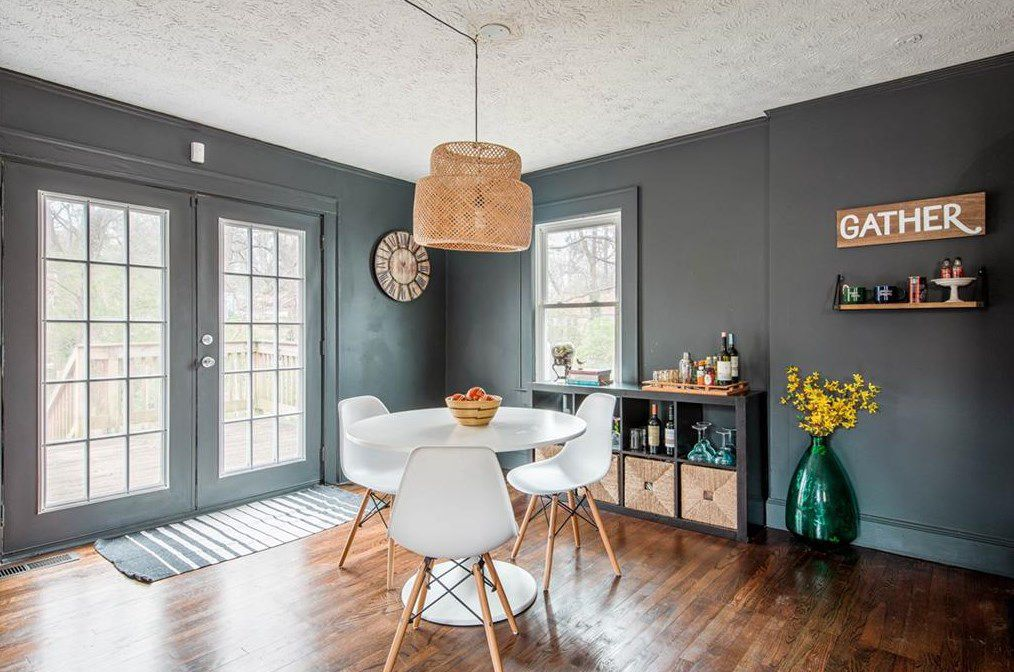 A gray dining room with french doors.