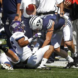 Weber State Wildcats running back Oran Maxwell (35) fumbles as he is hit by Brigham Young Cougars defensive back Daniel Sorensen (9 )during the first half as Brigham Young University plays Weber State University in football  Saturday, Sept. 8, 2012, in Provo, Utah.