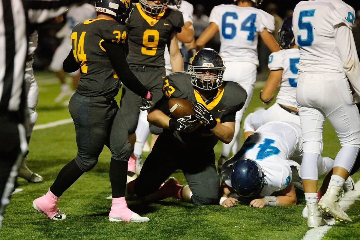 Cameron Fisher recovers a fumble in Summit Academy's win over Juan Diego Friday night. The senior has become a corner stone of the Bears defense despite dealing with health issues.