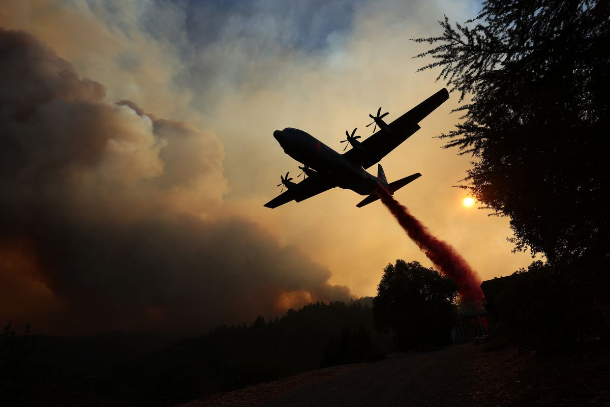 A Modular Airborne Fire Fighting Systems (MAFFS) equipped C-130 aircraft drops retardant ahead of the LNU Lightning Complex fire on August 20, 2020 in Healdsburg, California.
