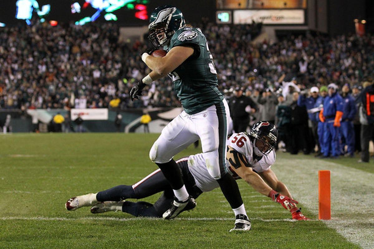 Owen Schmitt #32 of the Philadelphia Eagles scores a 5-yard touchdown reception in the fourth quarter against Brian Cushing #56 of the Houston Texans
