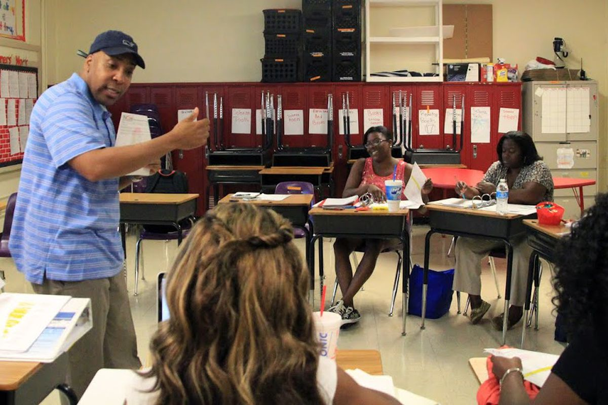 Principal Rodney Rowan works with reading teachers on instructional strategies they will use during the upcoming school year at Cherokee Elementary School, an iZone school in Memphis that posted big gains in its 2015 student test scores.