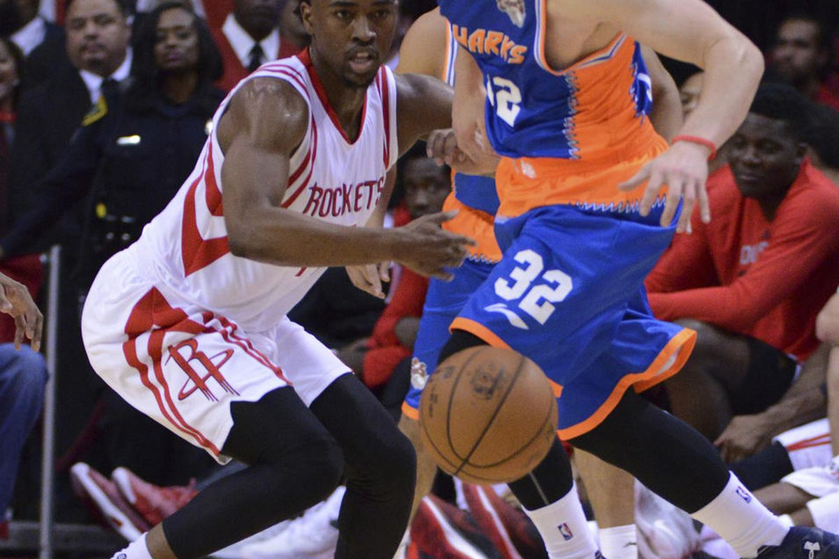 The Shanghai Sharks Jimmer Fredette (32) battles for the ball against the Houston Rockets Isaiah Taylor (17) in the second half of an NBA basketball exhibition game Sunday, Oct. 2, 2016, in Houston. (AP Photo/George Bridges)
