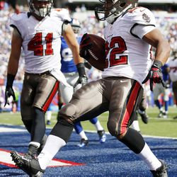 Tampa Bay Buccaneers running back Doug Martin (22) celebrates with  Erik Lorig (41) after rushing for a touchdown during the first half of an NFL football game against the New York Giants, Sunday, Sept. 16, 2012, in East Rutherford, N.J.