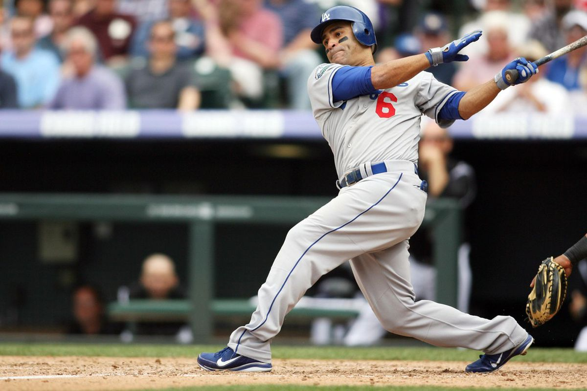 May 2, 2012; Denver, CO, USA; Los Angeles Dodgers third baseman Jerry Hairston (6) hits an RBI single during the eighth inning against the Colorado Rockies at Coors Field.  Mandatory Credit: Chris Humphreys-US PRESSWIRE