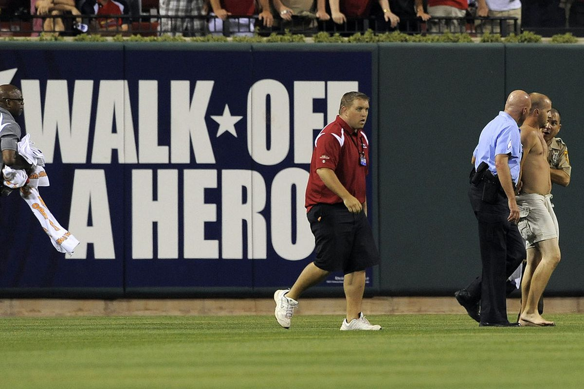 May 24, 2012; St. Louis, MO. USA; A streaker is removed from the field during the seventh inning of a game between the St. Louis Cardinals and the Philadelphia Phillies at Busch Stadium. Mandatory Credit: Jeff Curry-US PRESSWIRE