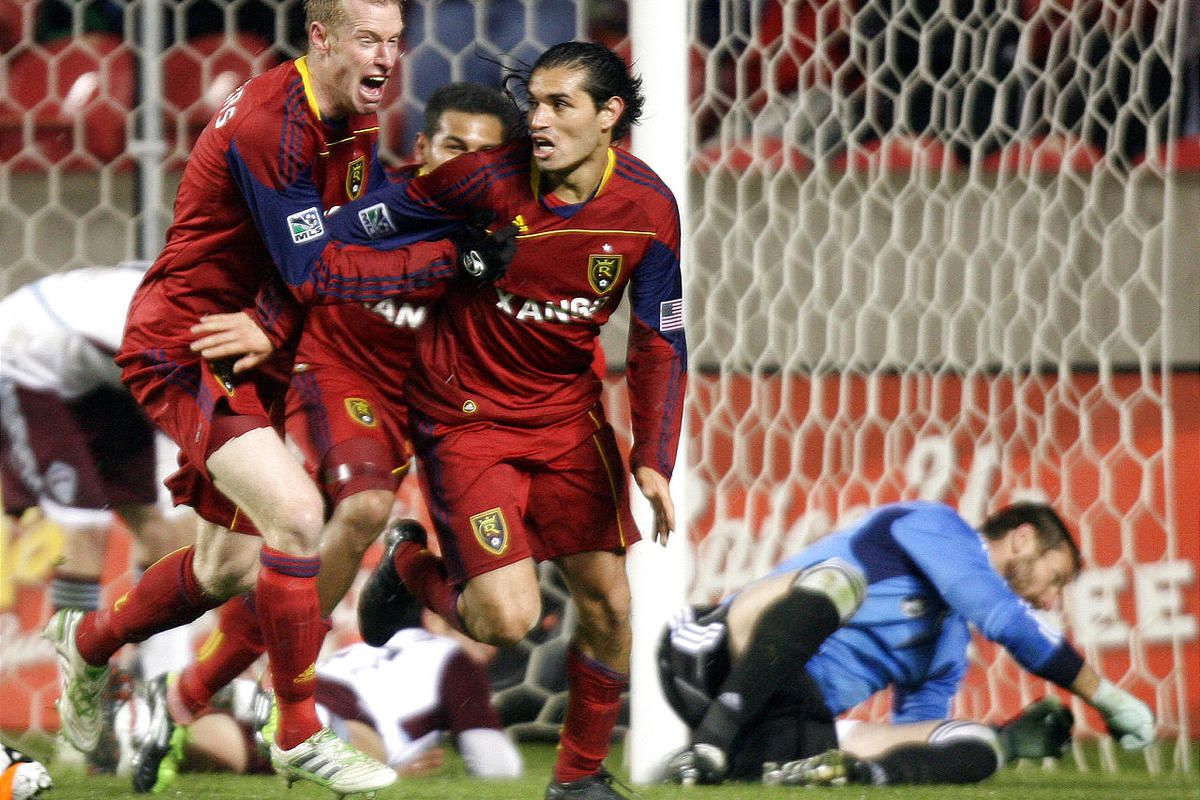 Nat Borchers, left, Paulo Araujo Jr., center back, and Fabian Espíndola of Real celebrate a stoppage-time goal that beats the Colorado Rapids and gives RSL the Rocky Mountain Cup.