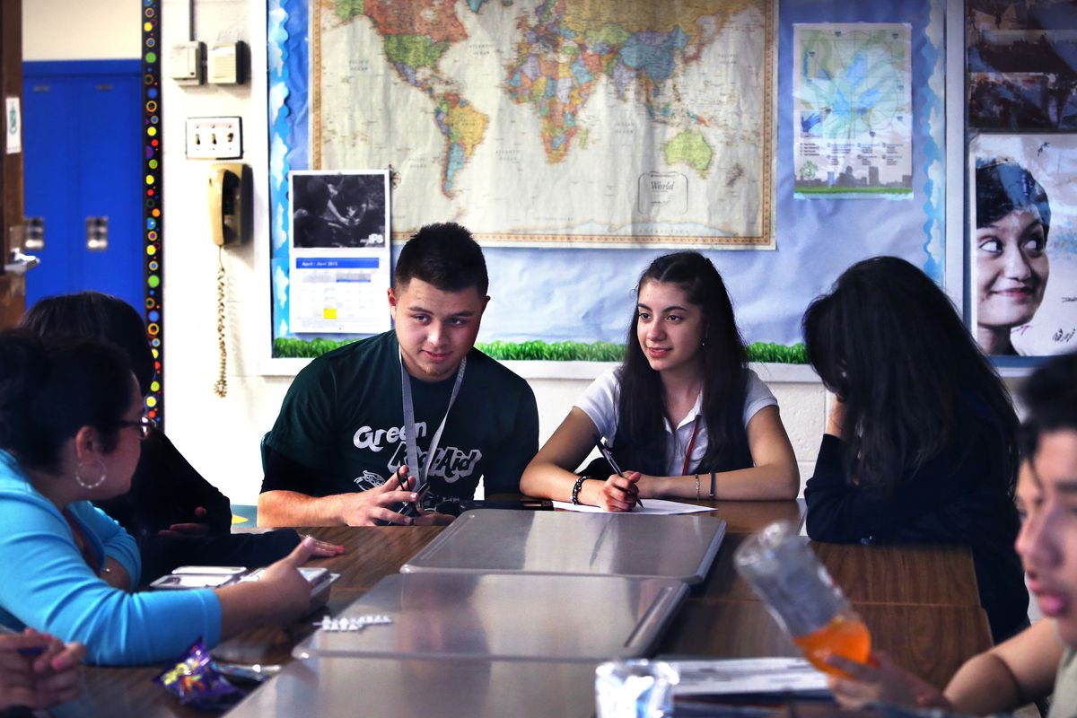 Cruz Tapia joins in a discussion among members of the United Northwest club about a documentary video on diversity during an after-school meeting at Northwest High School in Indianapolis. To his right is Maria Ulloa-Loza. Claudia Montes (left) is the college and career readiness adviser for English learners.