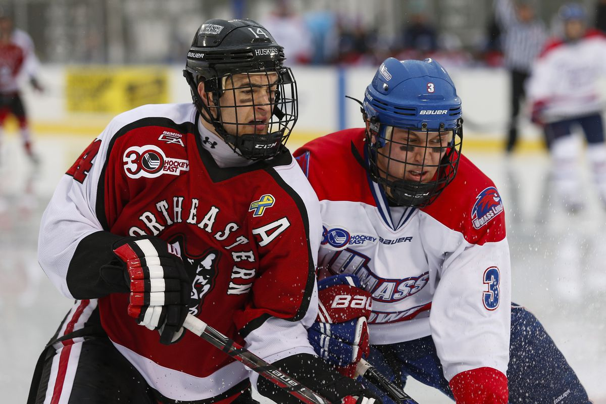 UMass Lowell's Michael Kapla races for the puck with Northeastern forward Braden Pimm at Frozen Fenway.