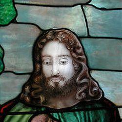Stained glass window is seen in Mill Creek Ward chapel before restoration.