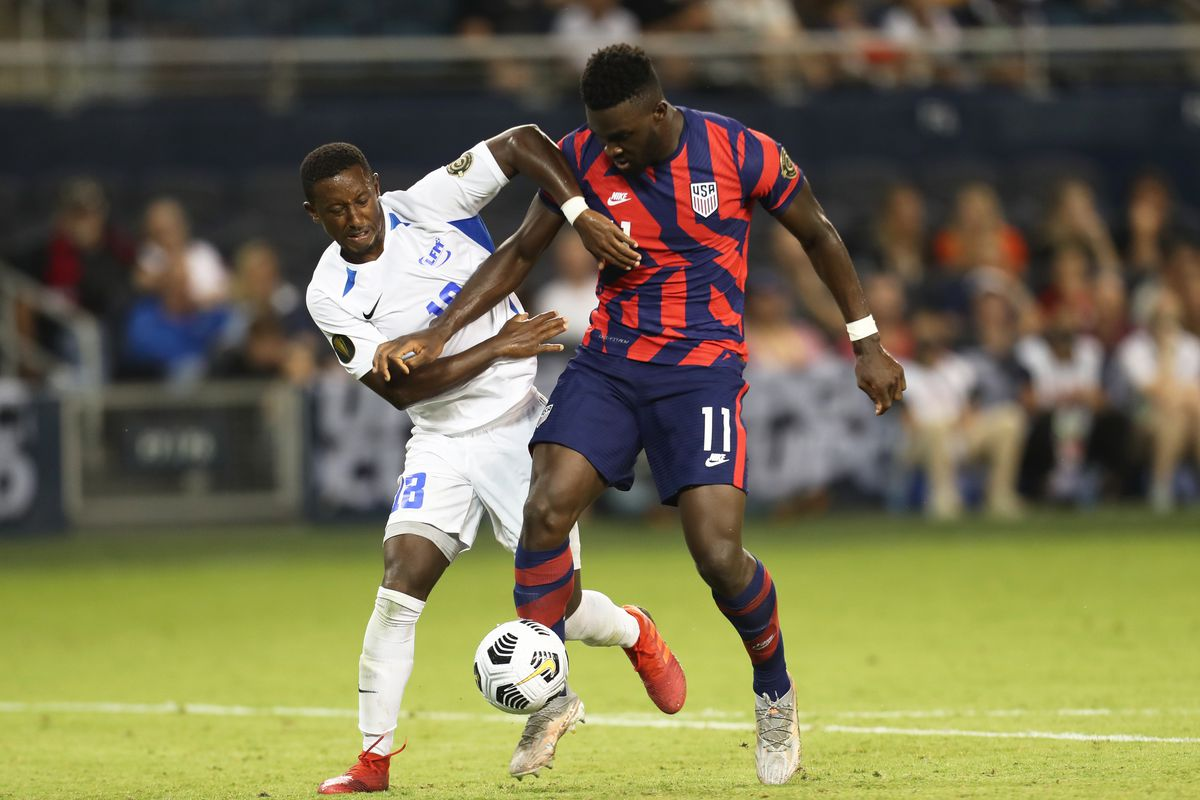 Daryl Dike #11 of United States and Samuel Camille #18 of Martinique fight for the ball during a Group B match as part of the 2021 CONCACAF Gold Cup at Children's Mercy Park on July 15, 2021 in Kansas City, Kansas.