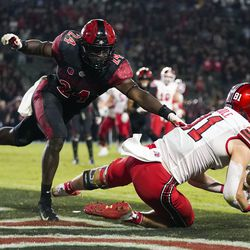 Utah wide receiver Connor O'Toole (81) tries to catch a pass in the end zone ahead of San Diego State linebacker Segun Olubi (24) during triple overtime of an NCAA college football game Saturday, Sept. 18, 2021, in Carson, Calif. The pass was ruled incomplete upon official review. San Diego State won 33-31.