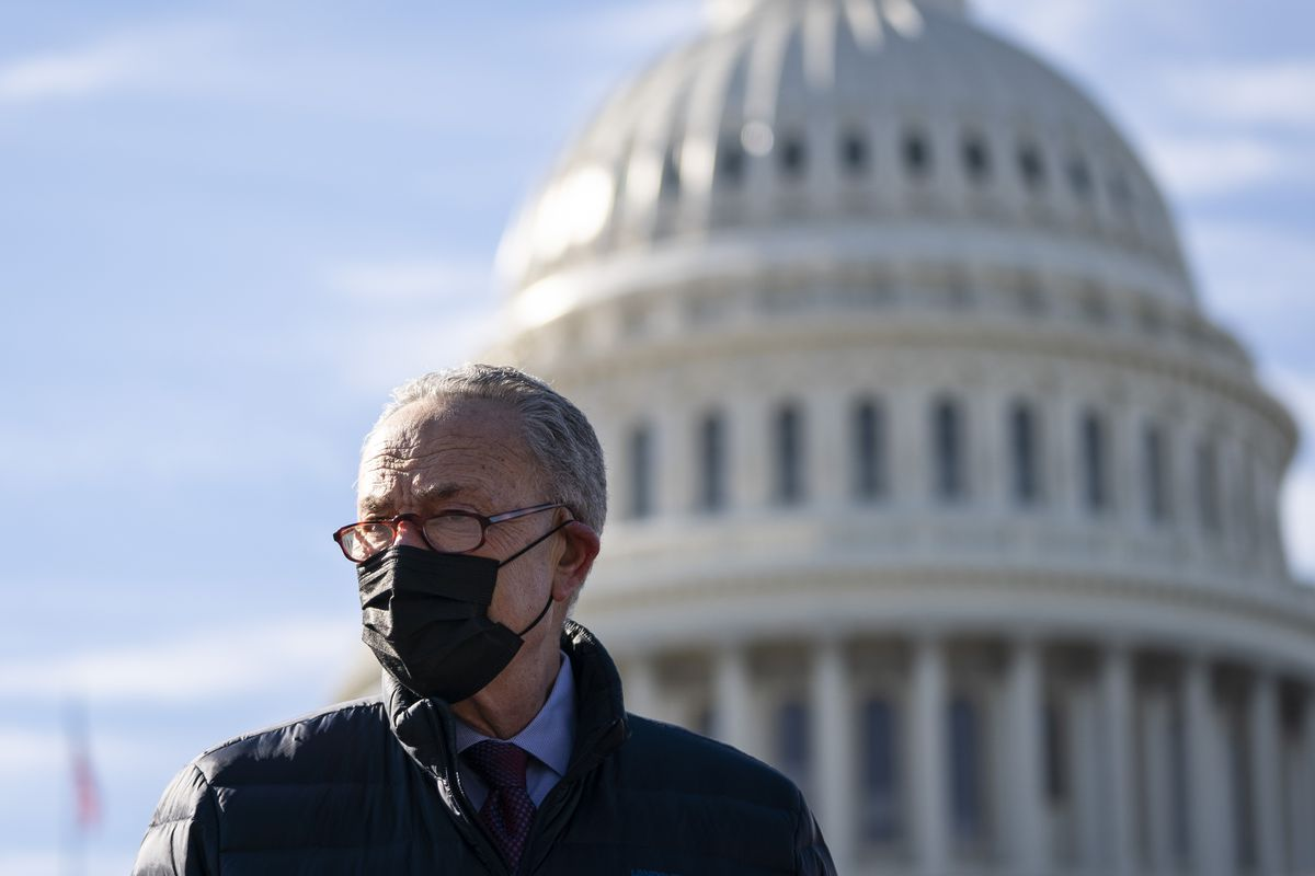 Schumer in front of the Capitol, wearing a mask.