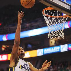 Utah's Dominic McGurie drive to the basket as the Utah Jazz and the Golden State Warriors play Tuesday, Oct. 8, 2013 in preseason action at Energy Solutions arena in Salt Lake City.