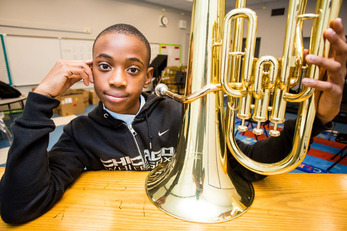 Xavier P., of Chatham, plays euphonium at the People's Music School, at the Bronzeville Classical School.