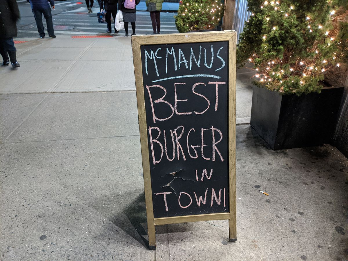 A chalkboard sign reads Best Burger In Town.