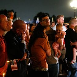 Darin Hoover, left, father of Marine Staff Sgt. Taylor Hoover, and other family members attend a vigil to honor Taylor Hoover's life and service at the Capitol in Salt Lake City on Sunday, Aug. 29, 2021. Hoover was one of the 13 U.S. service members killed by the terrorist attack at Hamid Karzai International Airport in Kabul, Afghanistan.