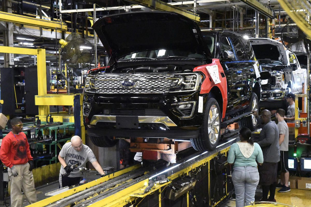 In this Friday, Oct. 27, 2017, photo, workers assemble Ford trucks at the Ford Kentucky Truck Plant in Louisville, Ky.