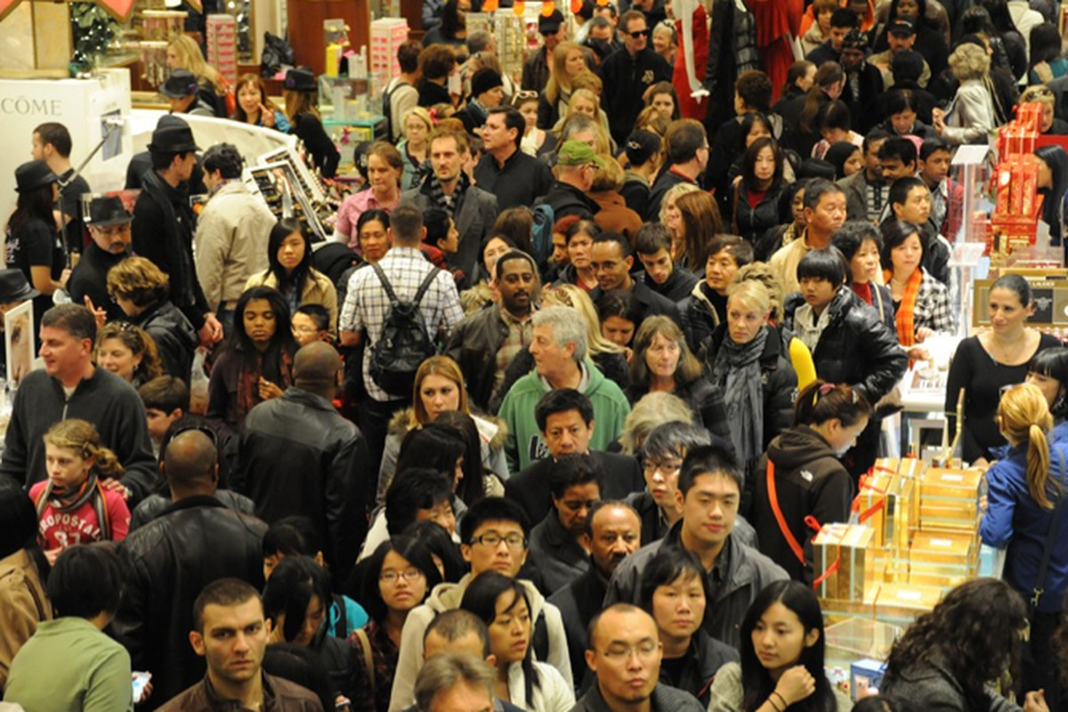 """The scene inside Macy's; image via <a href=""""http://www.wwd.com/retail-news/marketing-consumer-behavior/black-friday-off-to-strong-start-5390341/slideshow?browsets=1322501931778#/slideshow/article/5390341/0"""">WWD</a>"""