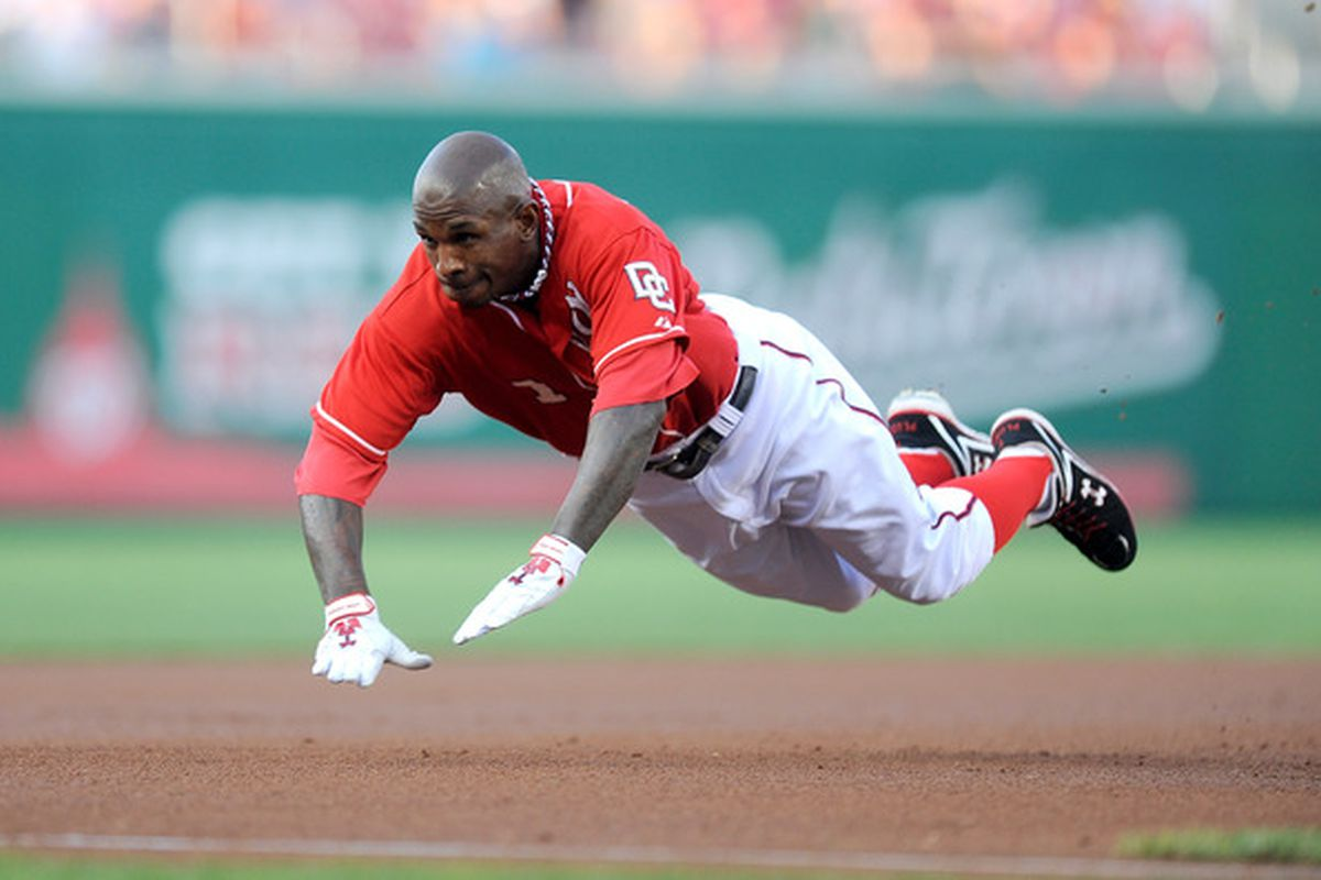WASHINGTON - JULY 30:  Nyjer Morgan #1 of the Washington Nationals slides into third base with a triple in the first inning against the Philadelphia Phillies at Nationals Park on July 30 2010 in Washington DC.  (Photo by Greg Fiume/Getty Images)