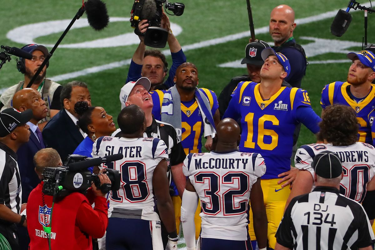 Rep. John Lewis, former U.S. ambassador to the United Nations Andrew Young and Rev. Bernice King look up at the coin toss prior to Super Bowl LIII between the Los Angeles Rams and the New England Patriots on February 3, 2019 at Mercedes Benz Stadium in Atlanta, GA.