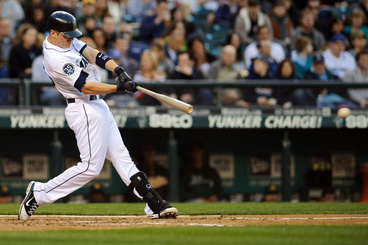 Apr 14, 2012; Seattle, WA, USA; Seattle Mariners shortstop Brendan Ryan (26) hits a single against the Oakland Athletics in the 6th inning at Safeco Field. Mandatory Credit: Steven Bisig-US PRESSWIRE