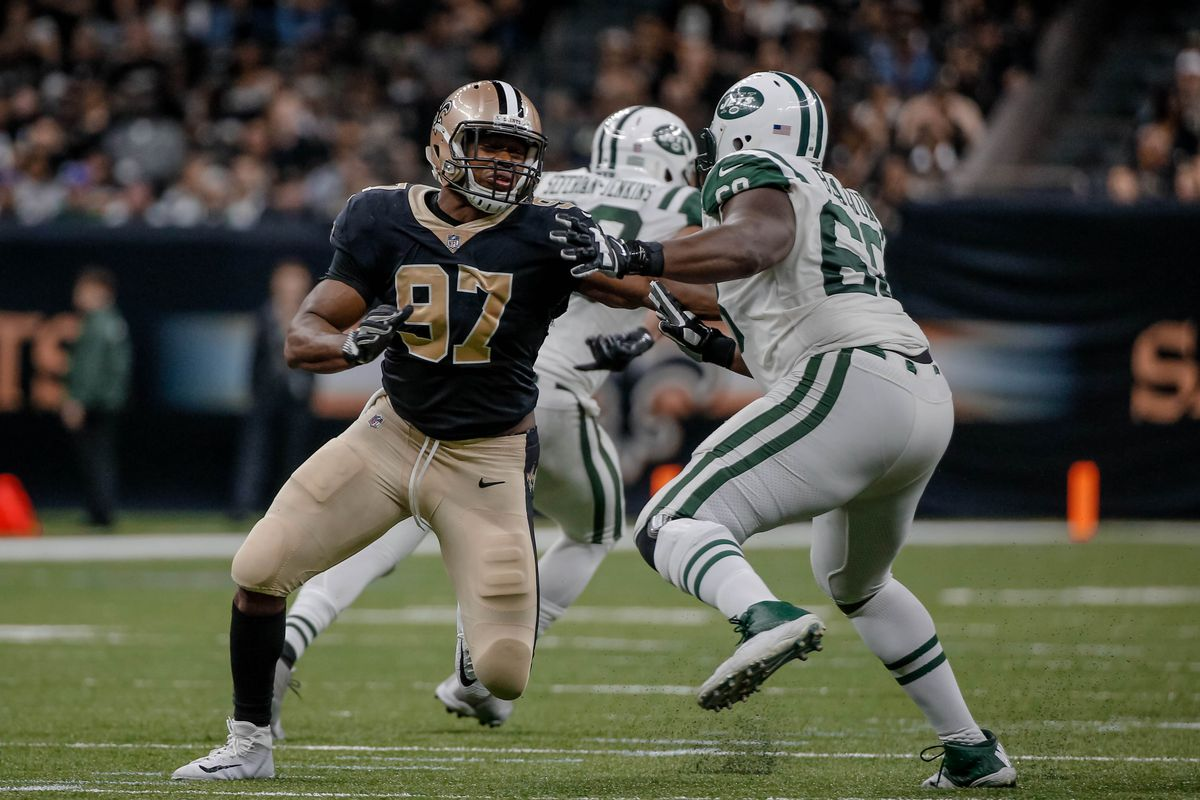 NEW ORLEANS, LA - New Orleans Saints defensive end Al-Quadin Muhammad (97) rushes against  New York Jets offensive tackle Kelvin Beachum (68) during the second  half at the Mercedes-Benz Superdome.